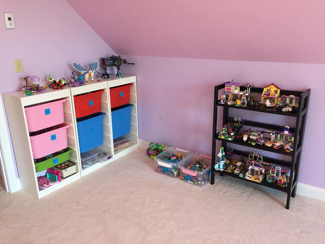 Playroom with bins for toys and lego bookshelf display