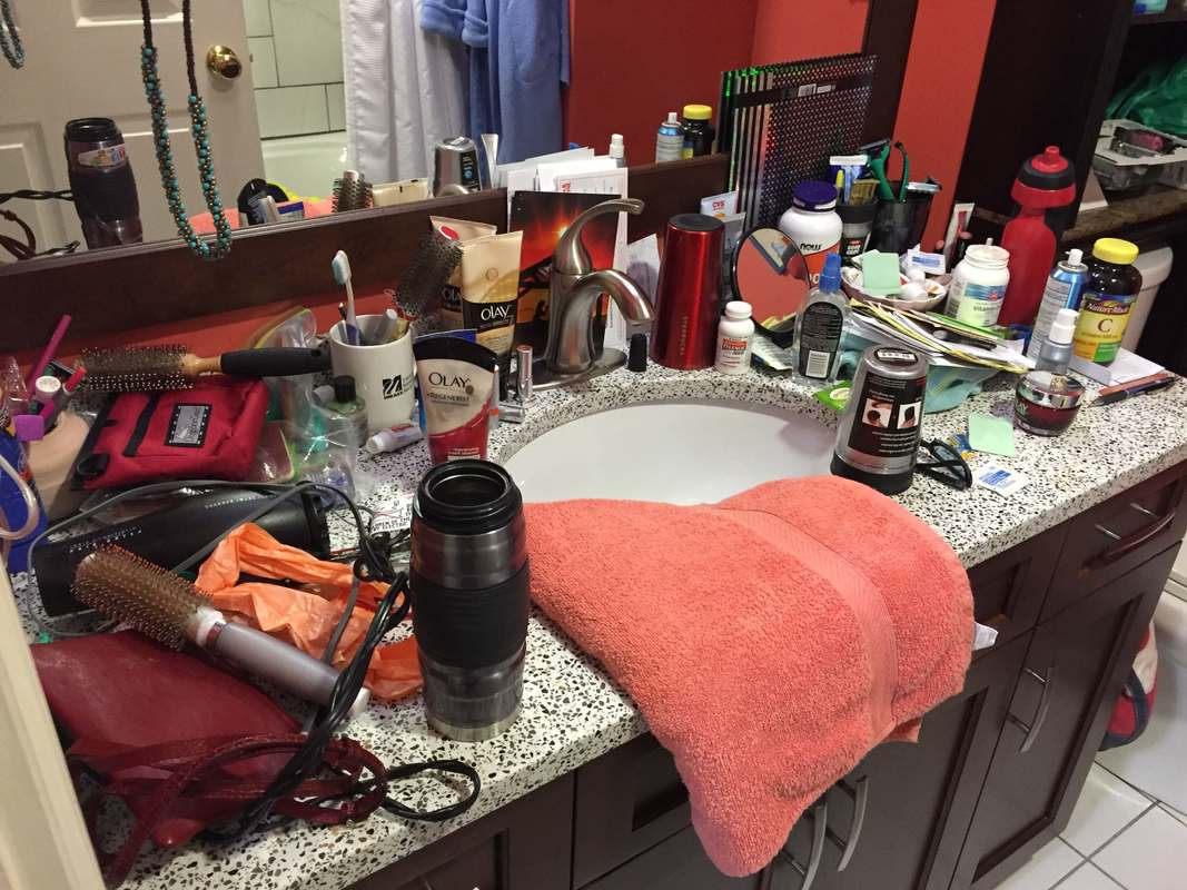 Before photo of a cluttered bathroom counter in Portsmouth, NH. Items are disorganized and get lost easily.