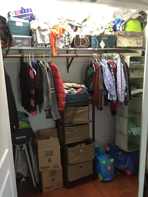 elementary boy's closet before with messy top shelf and unused space
