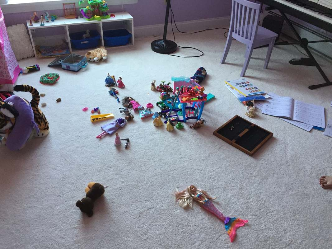 Before playroom with toys on floor