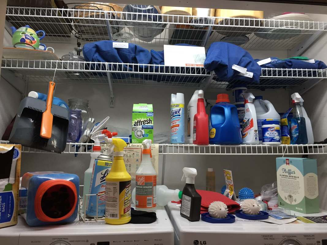 Before of above the laundry. Items fall off behind the washer dryer often. Cleaning supplies are disorganized.