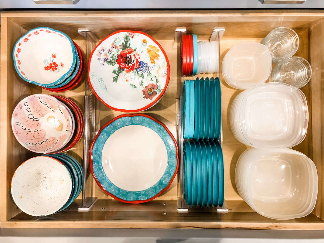Dishes and Tupperware with acrylic drawer dividers